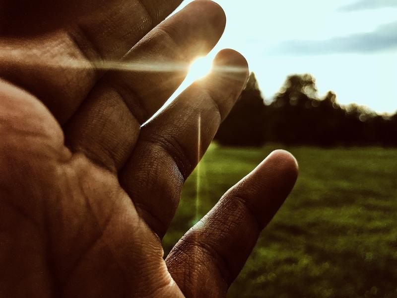 hand with sun harmony light